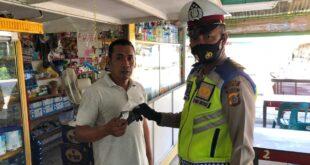 Sat Lantas Polres Pidie Melaksanakan Sosialisasi Penekanan Peningkatan Prokes 5 M dan Pembagian Masker Grtais